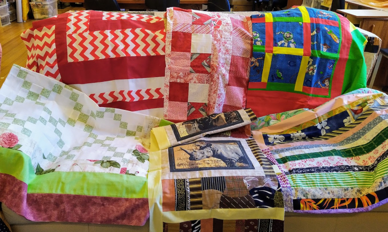 Ph 12 Nellies group - quilt tops second